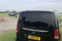 V88 next to helicopter