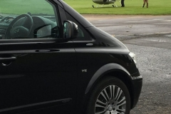 Viano next to helicopter